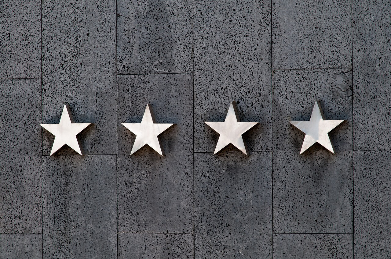 An image showing 4 silver stars on the wall