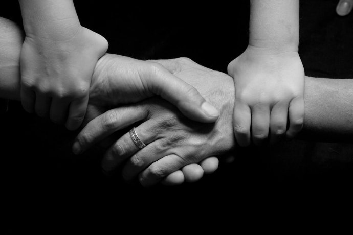 A number of joined hands.