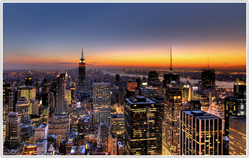 A photo of the NYC skyline at sunset.