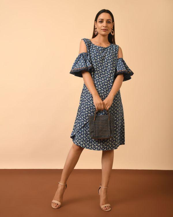 Model wearing Beautiful Indigo Dyed Dabu Print cold shoulder Dress holding bag