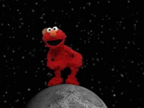 Elmo in space stepping on a fake planet