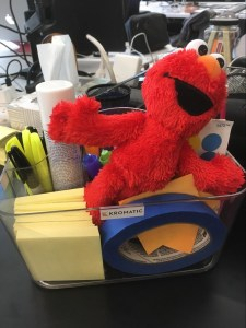 Elmo, the cute red monster from Sesame Street, in our supply caddy