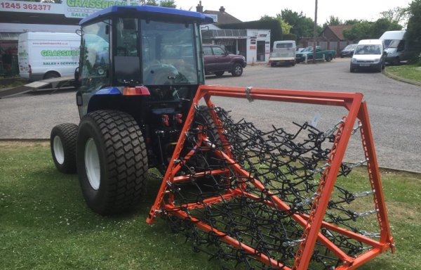 Iseki fitted with folding chain harrows