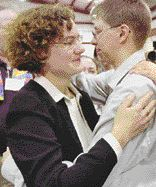 The Rev. Irene Elizabeth Stroud (left) hugs her partner, Chris Paige, in Pughtown, Pa., on Dec. 2. Stroud was a minister in the United Methodist Church until the denomination took away her credentials because she is gay. Photo by Bradley C. Bower / the Associated Press