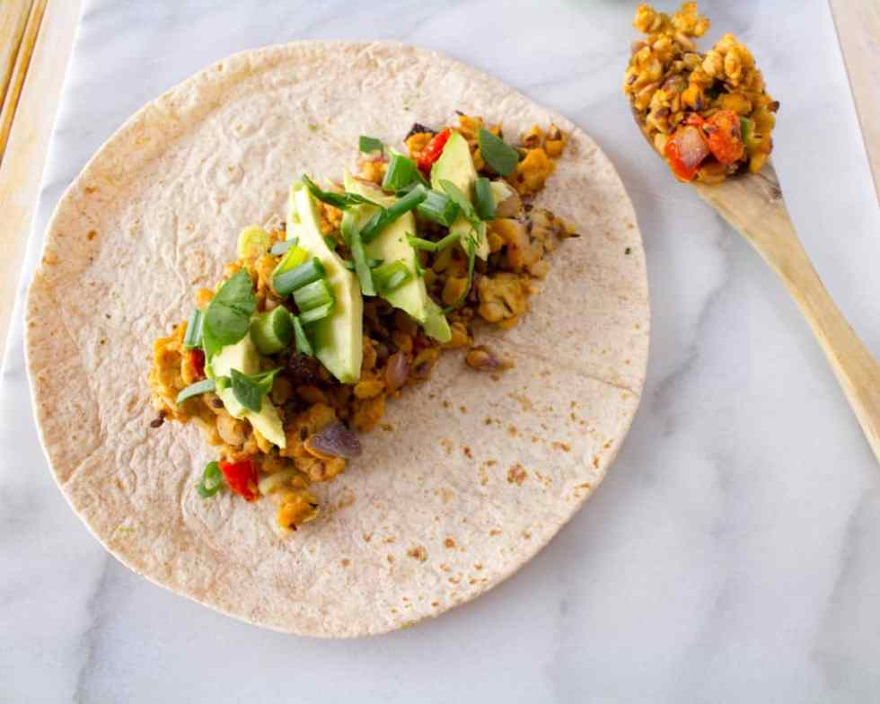 Vegan tempeh tacos and burritos are a favorite healthy, plant-based weeknight meal. Quick, filling, and (of course) delicious too, this meal has all the makings of a heathy homemade staple.