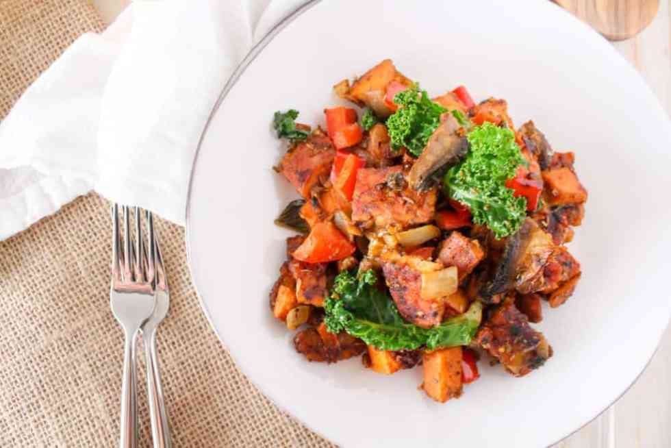 This Tempeh Bacon Hash recipe is made with sweet potatoes and mushrooms and is a delicious, healthy alternative to regular bacon breakfast hash.
