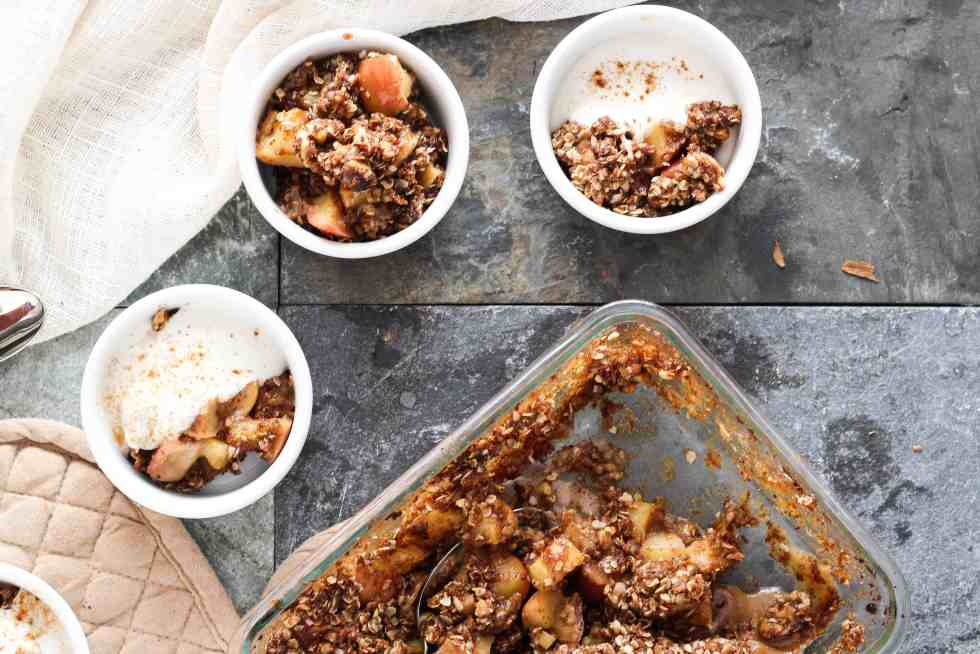 This easy vegan apple crumble is the perfect sweet treat for your next holiday party. Made with fresh seasonal apples and warming spices like cinnamon, ginger, and cardamom, this is a seasonal dessert recipe that even the most novice of bakers can pull off.