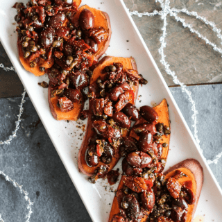 Sweet potato toast topped with a savory tapenade of olives, capers, garlic, and fresh herbs. Healthy holiday party appetizer! Vegan, Gluten-Free.