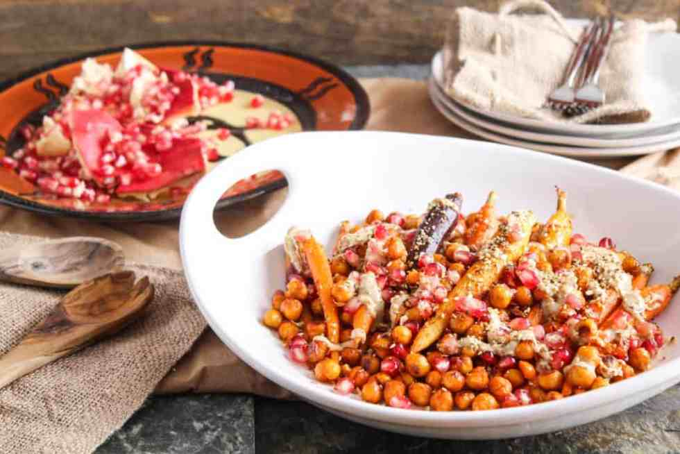 Roasted carrots with harissa, chickpeas, and pomegranate. A healthy and colorful plant-based (vegan) entree or side dish. Harissa, dukkah, & tahini flavors!