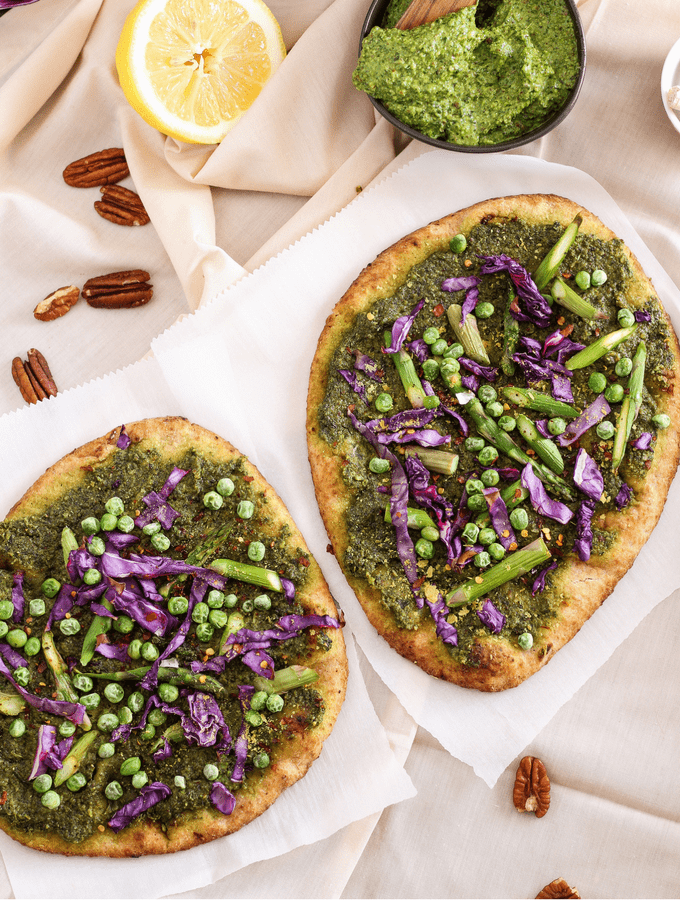 These plant-based pesto naan pizzas are a delicious way to welcome in the spring season. Topped with dairy-free pecan pesto and seasonal spring vegetables.