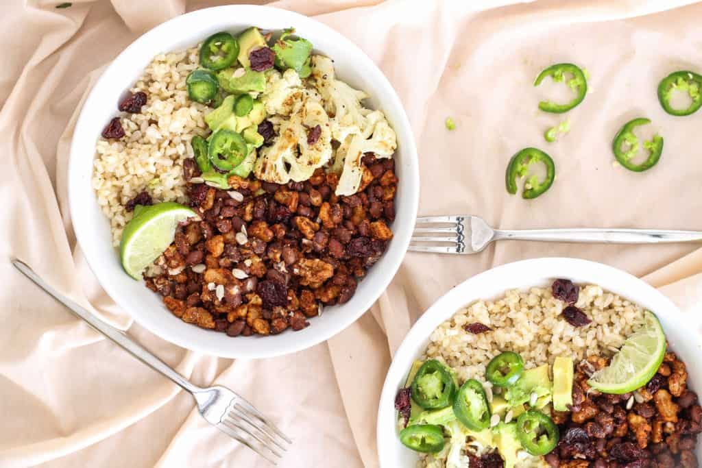 These flavorful walnut buddha bowls are made with black beans and delicious chili lime spices. Great for both packed lunches and quick weeknight dinners!