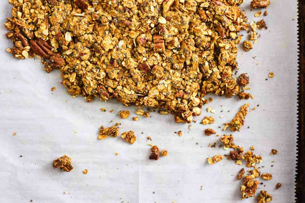 Golden milk granola is a delicious turmeric-based breakfast recipe with anti-inflammatory benefits. Mix with fruit and yogurt to make a healthy parfait!