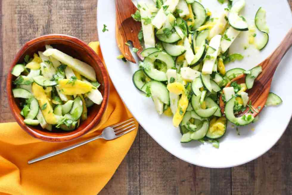 vUpgrade your go-to summer fruit salad with a colorful Mango Cucumber Salad with Jicama! Easy vegan/vegetarian and gluten-free recipe!