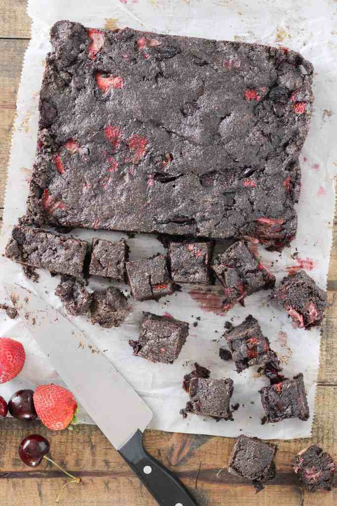 Brownie bites filled with fresh cherries and strawberries—a delicious sweet treat for your next summer party. Get the easy recipe and try them today!