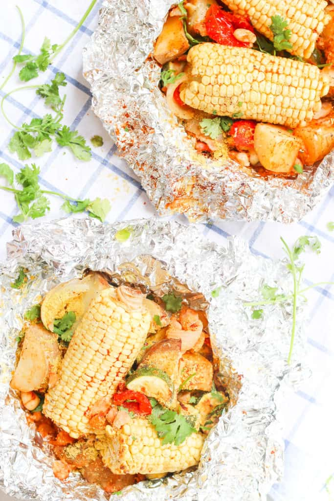Foil packs are the easiest way to get your vegetables and plant-based protein while camping! Made with potatoes, corn, white beans, garlic, and paprika.