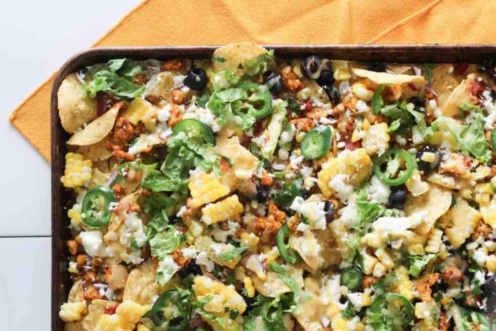 Whether it's a busy weeknight or a Sunday afternoon tailgate, this recipe for Easy Vegetarian Tempeh Sheet Pan Nachos is quick and easy perfection.