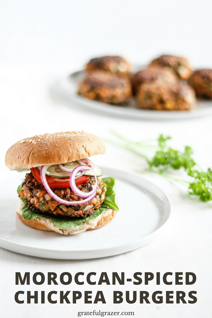 "Moroccan Chickpea Burgers on a white plate with text ""Moroccan-Spiced Chickpea Burgers"""