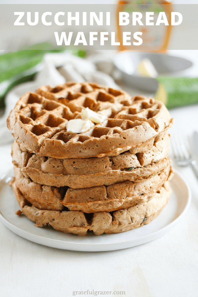 "Zucchini bread waffles stacked with butter on top on a white plate. Title text reads ""Zucchini Bread Waffles."""