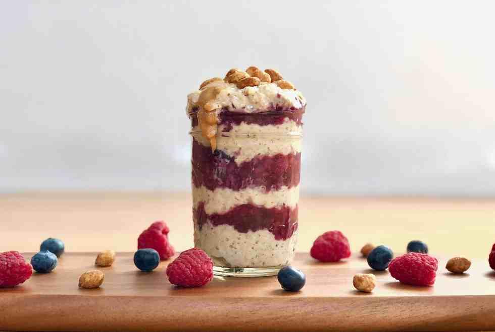 Food trends including gut-healthy yogurt parfait in mason jar.