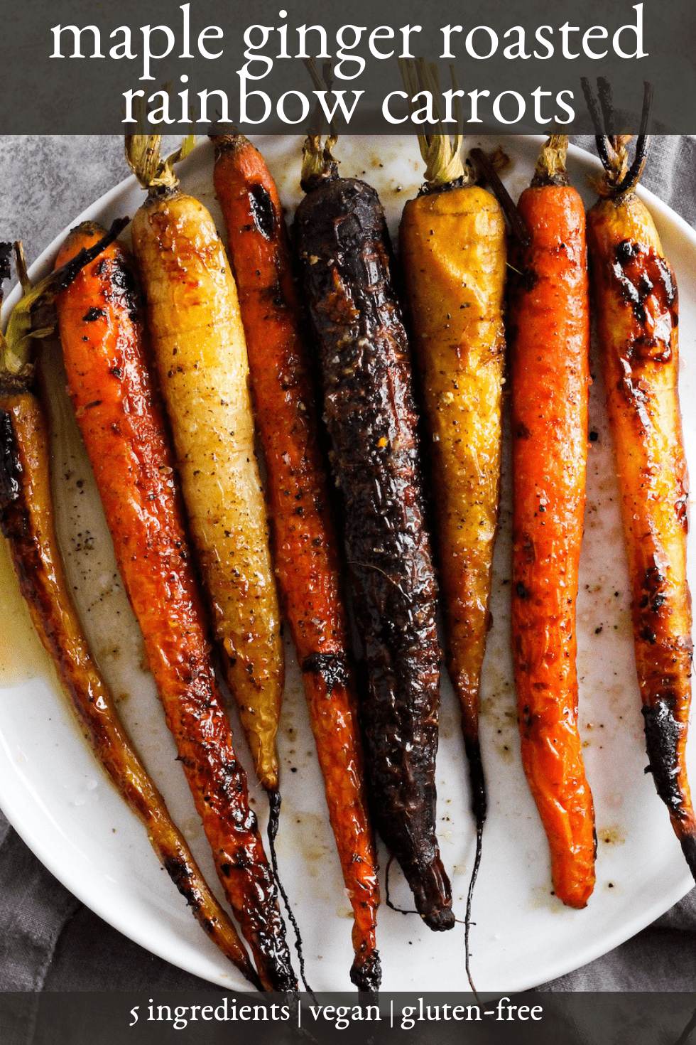 Roasted rainbow carrots make a colorful and delicious addition to your table. This recipe only has 5 ingredients and is naturally vegan, too! Good for the holidays or any day. Use regular (orange) carrots if you can't find rainbow!  #gratefulgrazer #plantbased #5ingredients #sidedish #rainbowcarrots #easyrecipes #healthyrecipes #veganrecipes