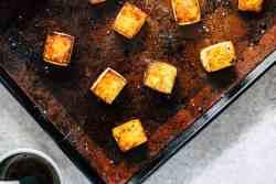 Horizontal image of crispy tofu on sheet pan.