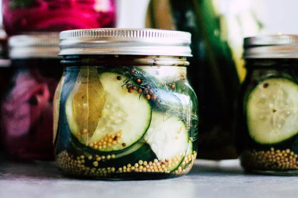 Mason jars filled with quick-pickled vegetables.