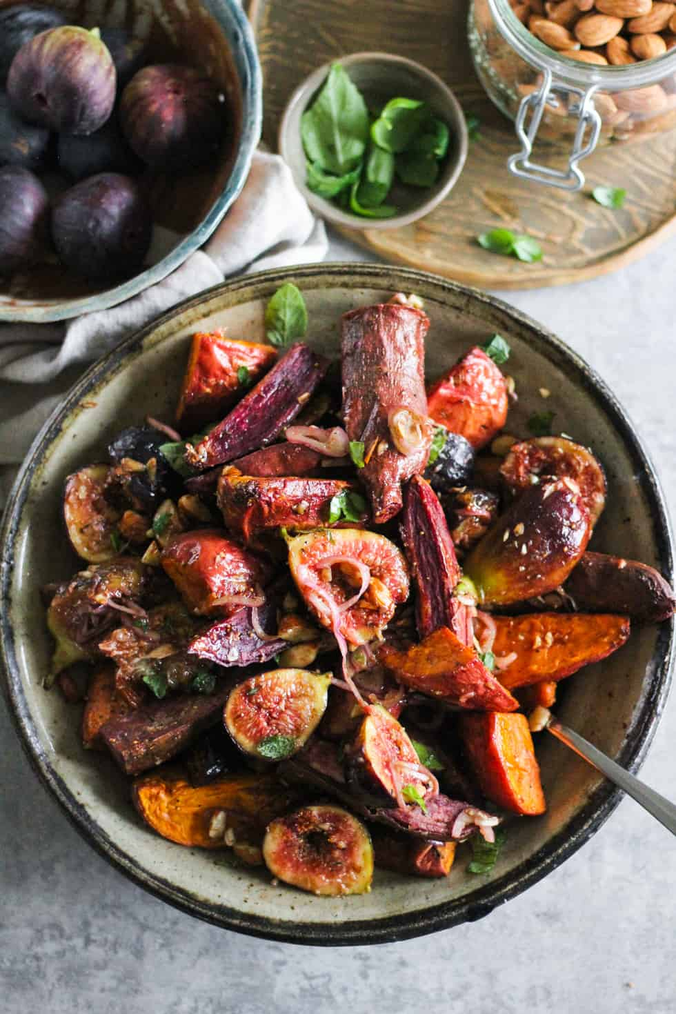 Sustainable living dish: figs and sweet potatoes in ceramic bowl.