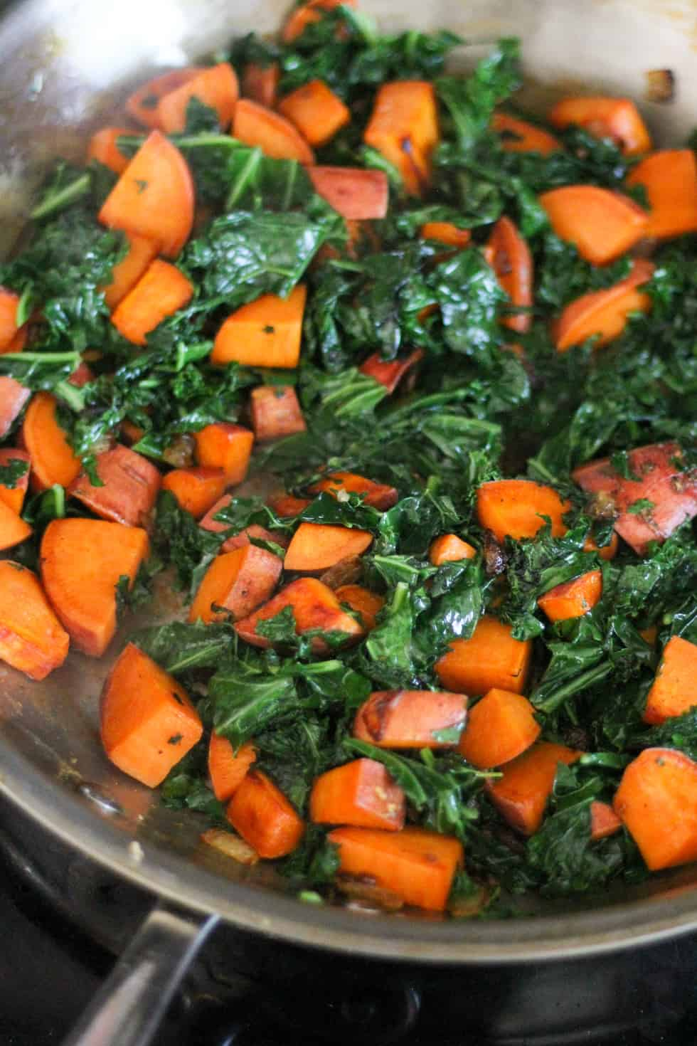 Sweet potatoes and kale in a frypan.
