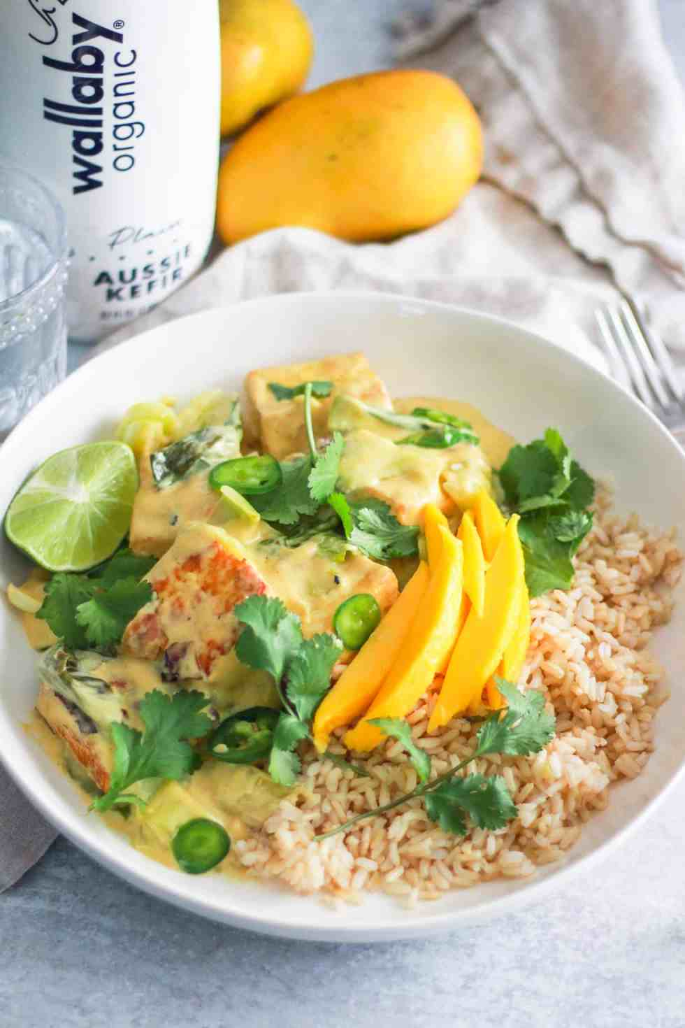 Mango tofu bowl with Wallaby Organic Kefir behind it.