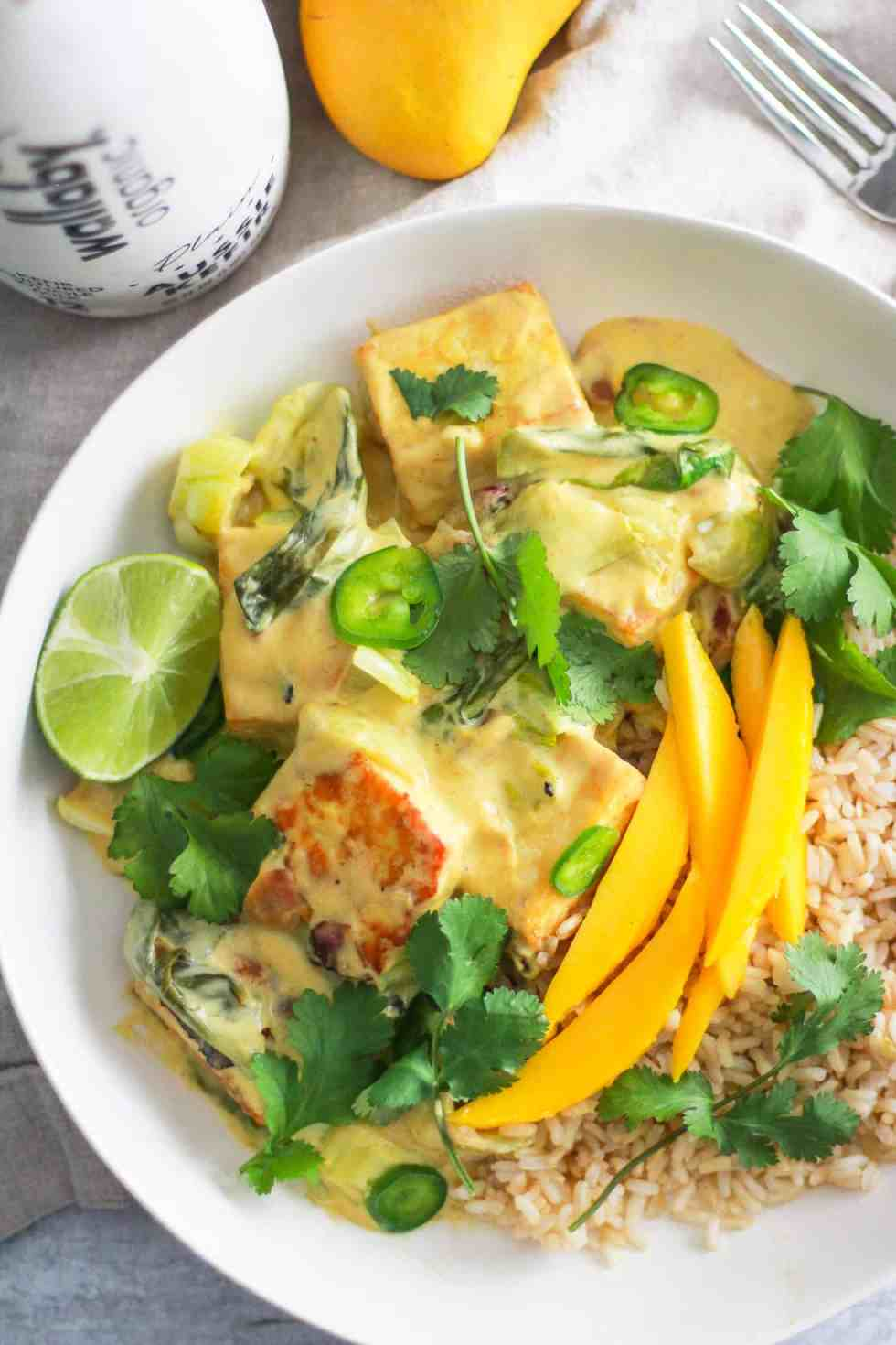Overhead image of mango pan-fried tofu with lime and cilantro.
