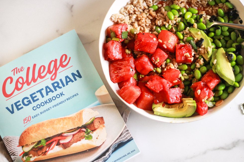 Horizontal image of The College Vegetarian Cookbook next to Watermelon Poke Bowl.