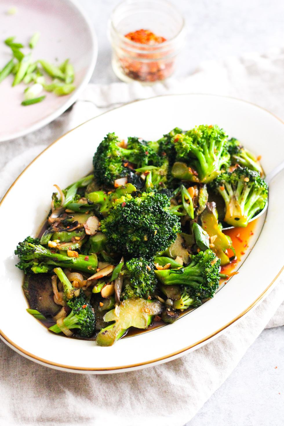 Broccoli stir-fry on a white platter for easy college meals
