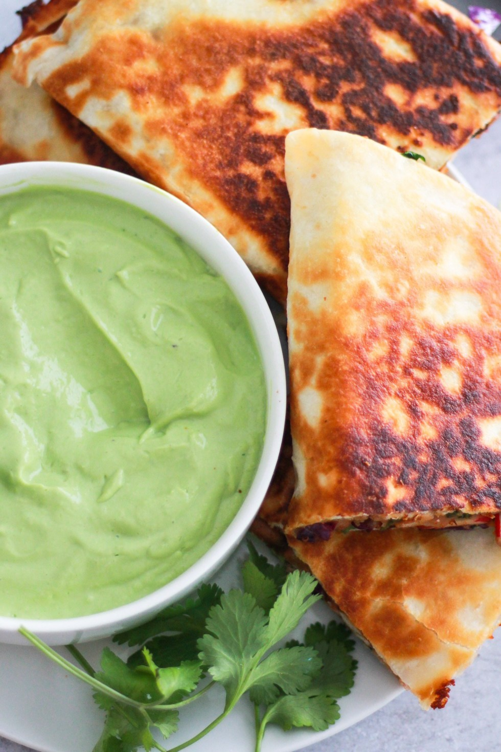Vegetarian quesadillas with avocado sauce are easy college meals
