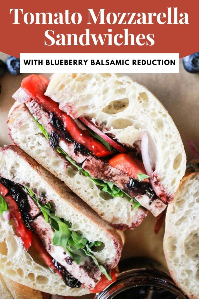 "Vegetarian sandwich on ciabatta rolls with red and white text that reads, ""Tomato Mozzarella Sandwiches with Blueberry Balsamic Reduction."""