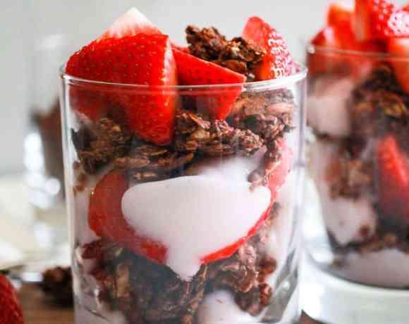 Strawberry Yogurt Parfait in a glass with granola.