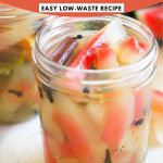 """Jar of watermelon rind pickles with pink and white text reading, """"Quick Pickled Watermelon Rind: Easy, Low-Waste Recipe"""""""