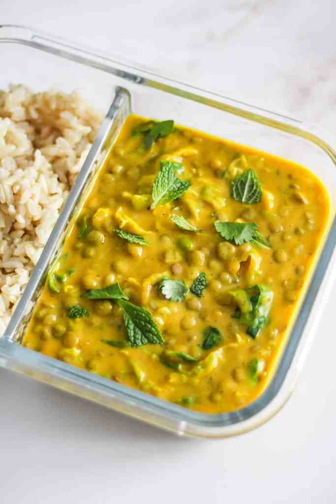 Butternut squash curry with rice in a glass meal prep container.