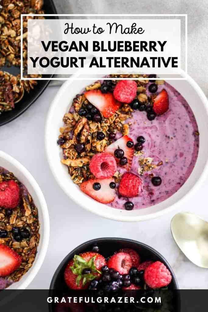 "Blueberry yogurt bowl topped with berries and granola with text reading, ""How to Make Vegan Blueberry Yogurt Alternative; GratefulGrazer.com."""