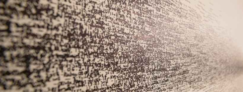 Thousands of words written on a white wall