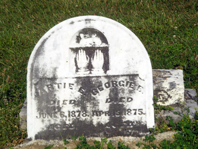 Tombstone of Artie and Georgie, Etna Cemetery, Etna, Licking County, Ohio. Photo by Amy Crow, 5 July 2009; all rights reserved.