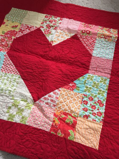 Bright red heart table topper