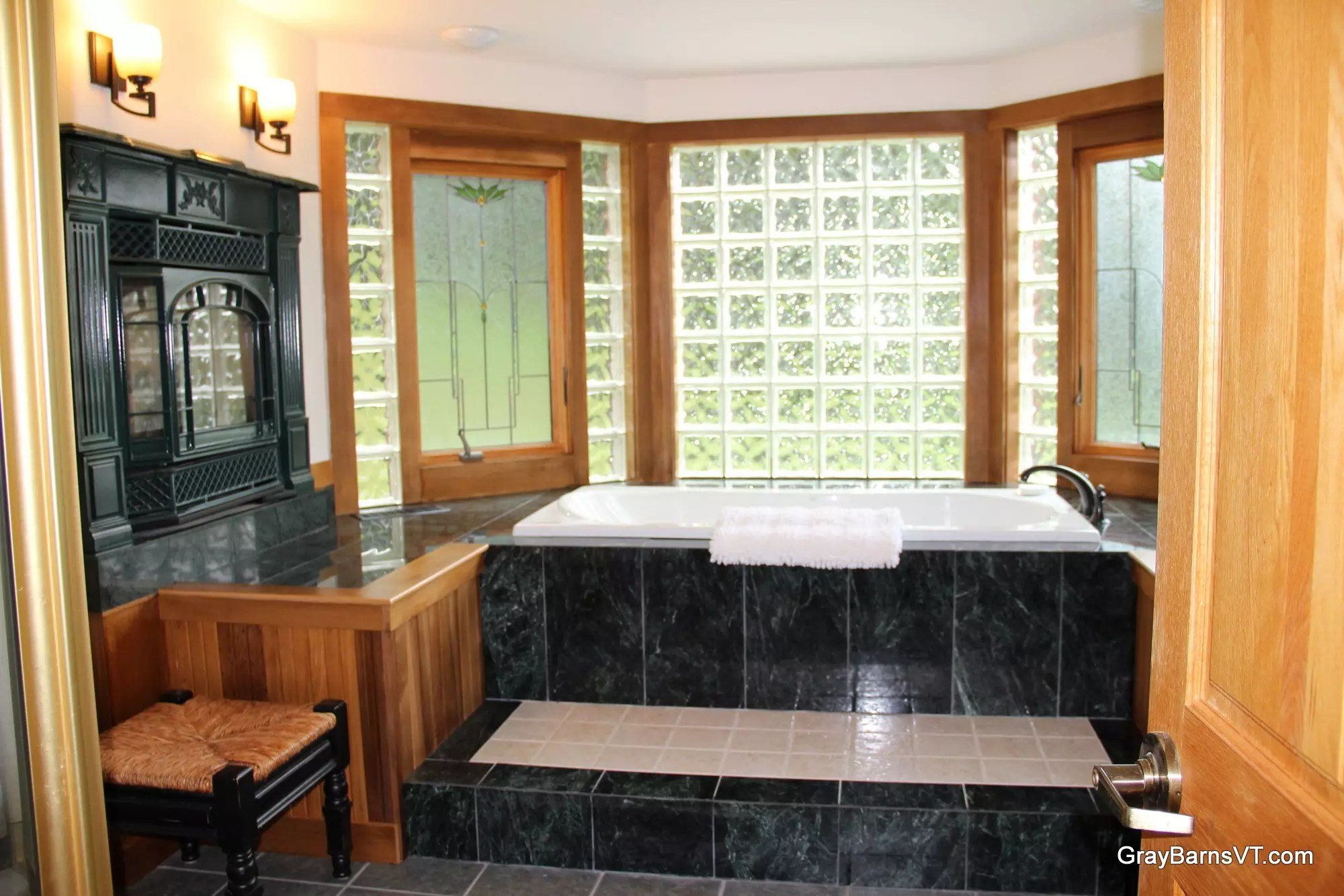 1st floor master bath marble, jetted tub, VT castings fireplace +