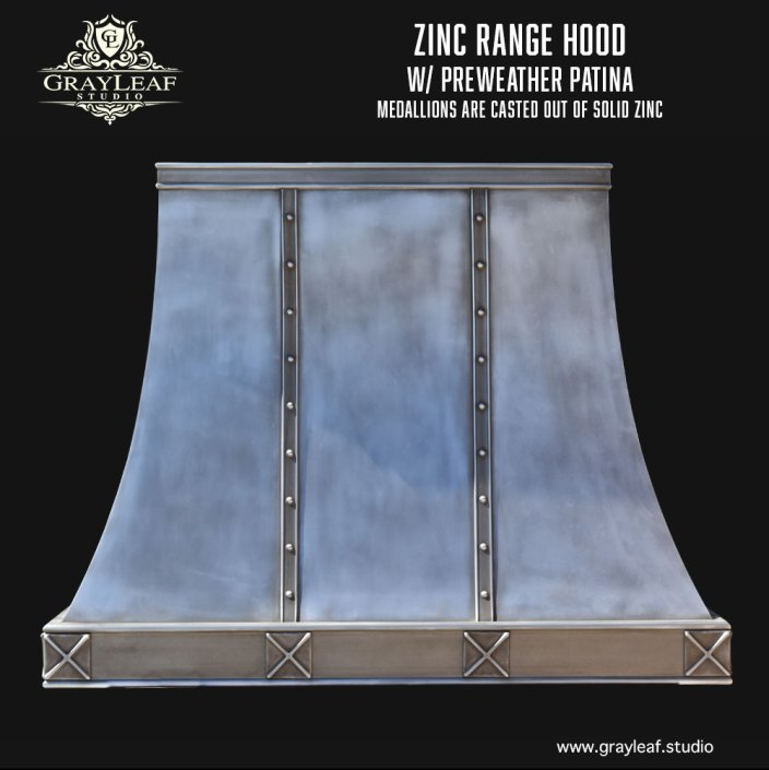 Zinc custom range hood with medallions made of solid casted zinc