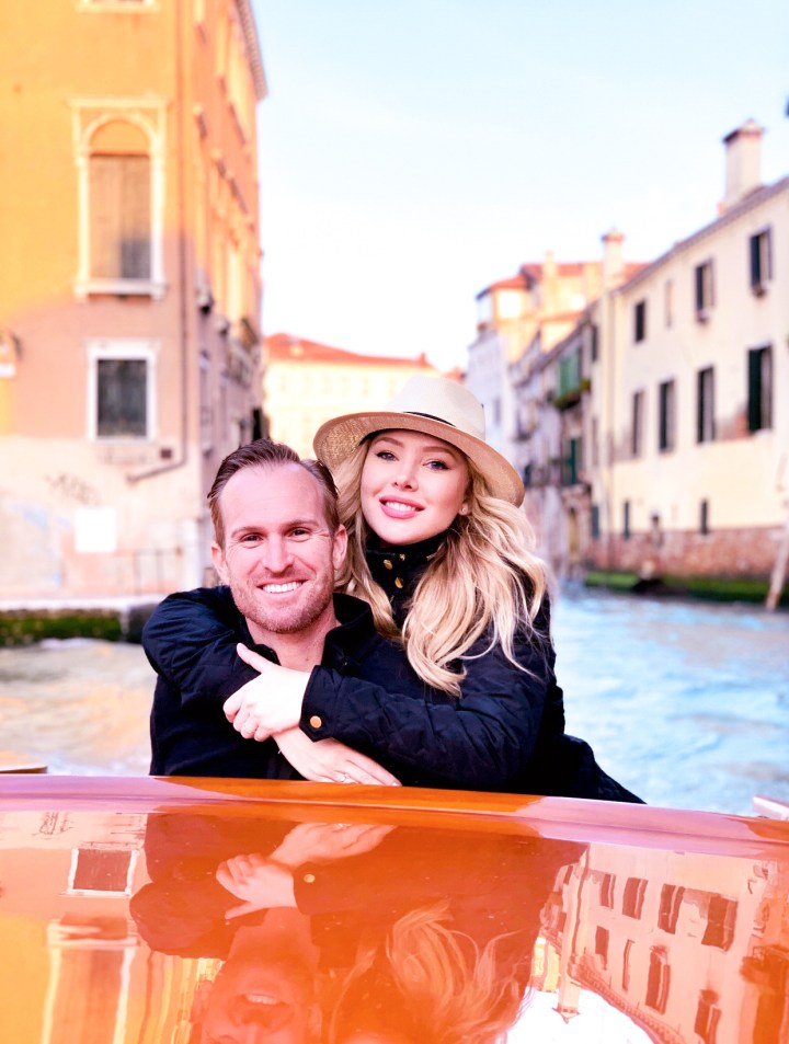 Picture of my husband and I on a boat in Venice, Italy on about page on grays through life blog