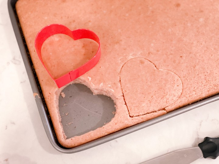 Cutting cake with a heart dhaped cookie cutter