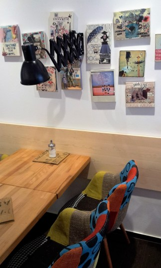 One of the tables showing the artsy interior of the café