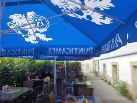 The patio, pub garden is protected by sun shades