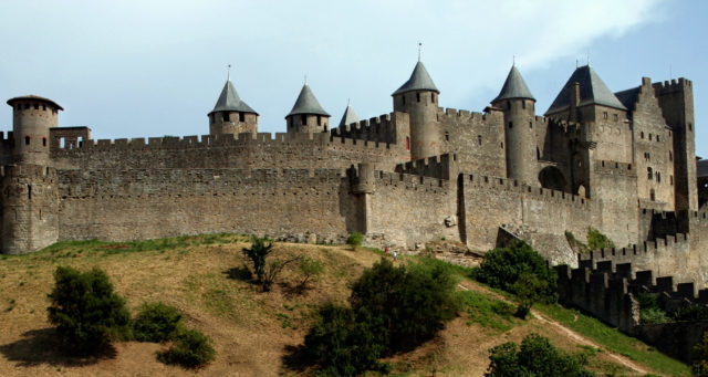 Carcassone, France - July 26, 2012: Medieval citadel of Carcassonne. Carcassonne is in the Aude department and chief town of the Languedoc-Roussillon region in the south-west France. Its historic center consists of a walled medieval citadel protected by UNESCO since 1997.