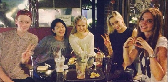 Emma in Seoul with a wide variety of nationalities at one dinner table