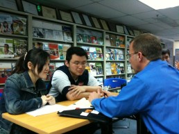 Mark Montgomery works with Chinese students